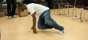 Daniel Morrison from Moon Runners b-boy crew spins on the ground.