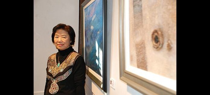 Hee ja Kim shows her acrylic paintings, including 'Different Views of Reality', right.