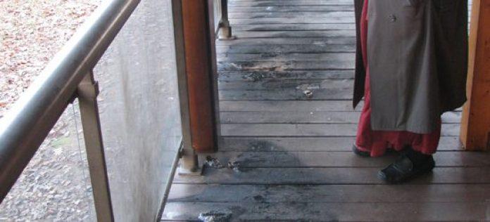 A monk surveys the damage done to the Maha Vihara Buddhist Meditation Centre's porch.