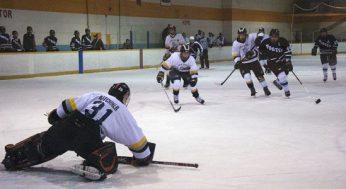 Porter assistant captain James V., #44, gets a shot on King Academy goaltender, Ian Kitchner #31.