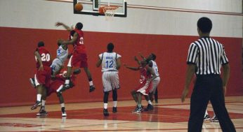 Laurier guard, Frank Water #23, tries to draw a foul, while driving to the hoop.