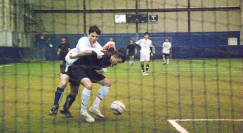 Victoria Park player #9 defends against East York player #12.