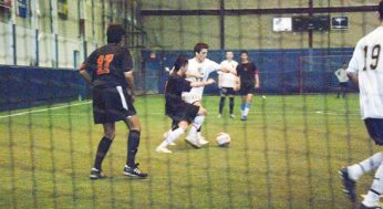 East York's #17 and Victoria Park's #9 fight for possession of the ball.