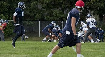 Slotback Chad Rempel lines up on the right end, while WR Reggie McNeal moves in motion.