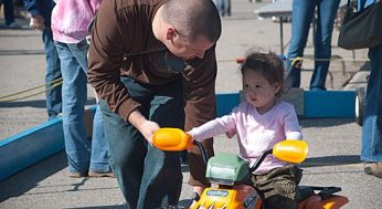 A youngster gets some help from her dad at the 17th annual Family Day. Held on Sept. 18, the event was also a celebration of the 50th anniversary of the West Rouge Sports and Recreation Association.