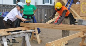 Teams of volunteers work together in helping to build 29 townhouses at 4572 Kingston Rd. on Sept. 24. From Sept. 20 to 25, the Habitat for Humanity Toronto ReTooling Blitz Build attracted more than 900 people.