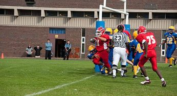 Danforth Collegiate and Technical Institute's Genesis Amoral (centre) breaks through Sir Robert L. Borden Business and Technical Institute's defence on his way to one of his two touchdowns on Oct. 6. Danforth cruised to an easy 48-0 win.