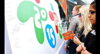 Revellers at the unveiling of the 2015 Pan Am Games logo leave their autographs on a poster of the logo outside the Air Canada Centre on Sept. 29.
