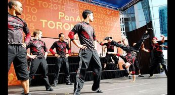 B-boys entertain the crowd gathered for the unveiling of the 2015 Pan Am Games logo outside the Air Canada Centre on Sept. 29.