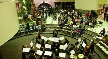 The Agincourt Collegiate Band performs at the Scarborough Civic Centre tree-lighting event Dec. 1. Some event attendees sat to watch the performance while others enjoyed other activities, such as taking photos with Santa. The event also included several other performances.