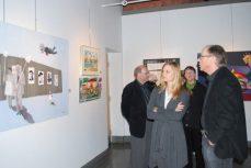 Gallery visitors examine Maryann Murphy's 'Self Portrait At Three'.