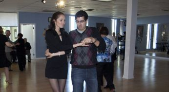 Shall We Dance instructor, Natalia Kirillova salsa dances with a beginner on the 7th anniversary celebration and open house on Oct.1.