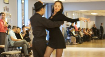 Natalia Kirillova and Feng Shang show off one of their stage dance numbers. The two came in second place for the number at the CanAm dance sport competition.