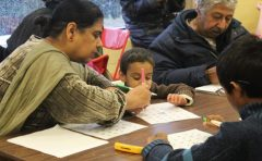 Family members participate in the Toronto Public Library's 'Marathon' bingo. This is the second year bingo was played at the festival.