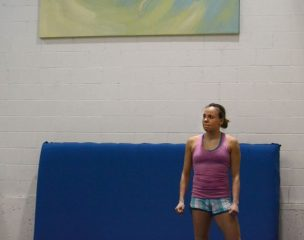 Karen Cockburn watches teammate Rosannagh MacLennan practice on the trampoline at Skyriders Trampoline Place. Cockburn has helped guide and prepare MacLennan for international competitions in the years they have been training and competing together.