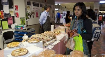 A student checks out the bread and pastries section. There were both meat and vegetable pastries available.