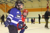Young hockey players, enjoy the benefits of their newly improved rink.
