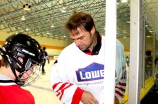 Cujo chats with a fan before sliding off to skate.