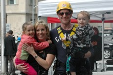 Dad Brad Blackborow, 37, gets a hug from his family after he completes the challenge.
