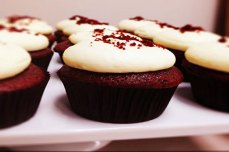 A close up of a red velvet cupcake. One of the popular regular line of cupcakes put out daily