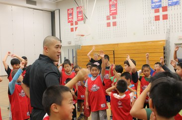 Ron Yeung energizes the kids before running them through their drills for the day.