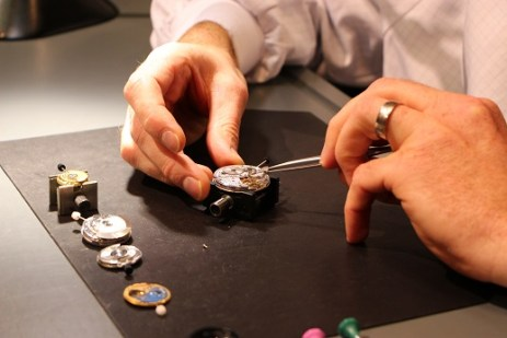 Watch parts being placed ever so carefully