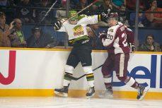 Battalion's Brendan Miller hits Petes forward Nick Ritchie.