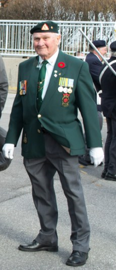 Dalton Moore walks in the parade before the Remembrance Day ceremony at the Scarborough Civic Centre.
