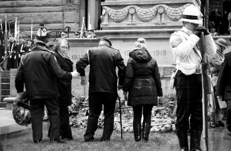 An unidentified veteran makes his way to the cenotaph outside Toronto's Old City Hall.