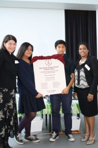 Blessed Pier Giorgio Frassati Catholic School receives its school plaque. Joined by two students are Mary Vascotto (left) and Thuvi Christy, the CSAC Co-Chairs.