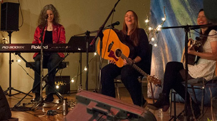 From left to right, Jane Lewis, Laura Bird, and Jessica Bundy share a laugh during a singing break.