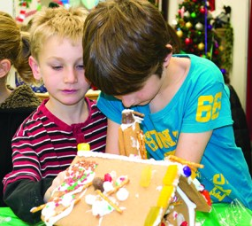 Calder Forbes, left, and Hugh Zachariah at the 11th annual Gingerbread Build organized by Habitat for Humanity.