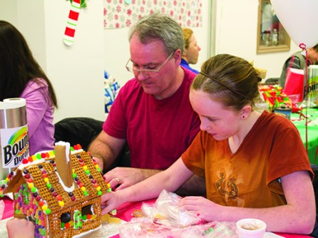 Mike Fenton, left, with his daughter Erin at the 11th annual Gingerbread Build organized by Habitat for Humanity.