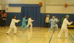 Tai Chi members exhibiting silky traditional costumes of the meditation technique.