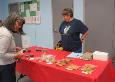 Kathy Thomas operates her bake sale table.