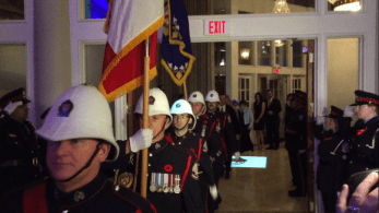 Police march as they enter the gala, following the honourable chairs.