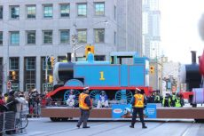 A giant float of Thomas the Tank Engine chugs along the parade route.