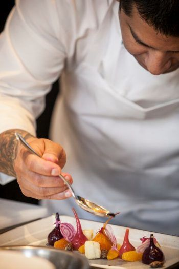 A Starr Catering chef adds the finishing touches. Photo by Steve Legado