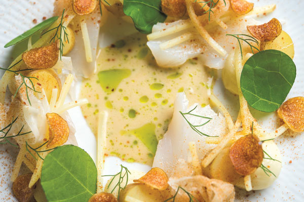 A sampling of cuisine from Claus Meyer's Agern: Cod with potatoes, fennel, and nasturtium (photo by Evan Sung)