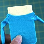 Fold some paper and insert into jumpsuit to stretch it flat.