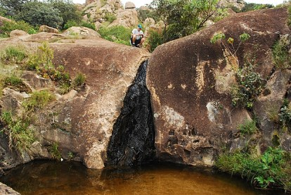 A lava flow over basalt bedrock yields clues of El Diente's origins, Medin explains.