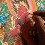 Artist painting Kurukulla