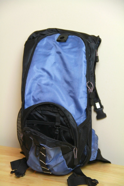 picture of Outdoor Product Ripcord backpack from back with pocket open