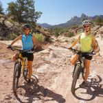 two mountain bikers on desert trail