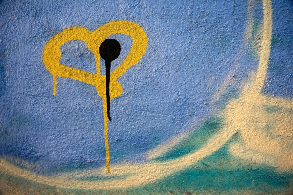 Graffiti of pierced bleeding heart with dark spot
