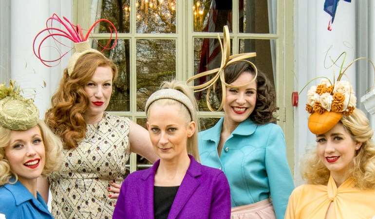 Emily Baxendale with models presenting Hats Off collection.