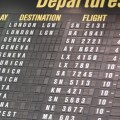 An airport arrivals and departures board.