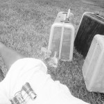 Vintage-Luggage-Sitting-in-the-Grass