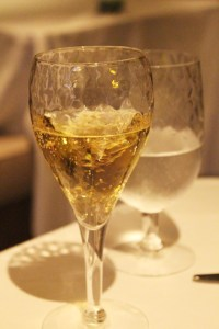 Norwegian-Breakaway-Ocean-Blu-Taittinger-Champagne-in-glass-TravelXena