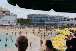 Maho-Beach-747-Take-Off-People-in-Water-TravelXena-7